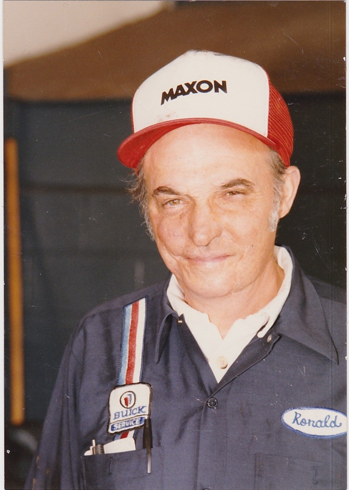 Photo of Ronald Cherry in shop with red cap